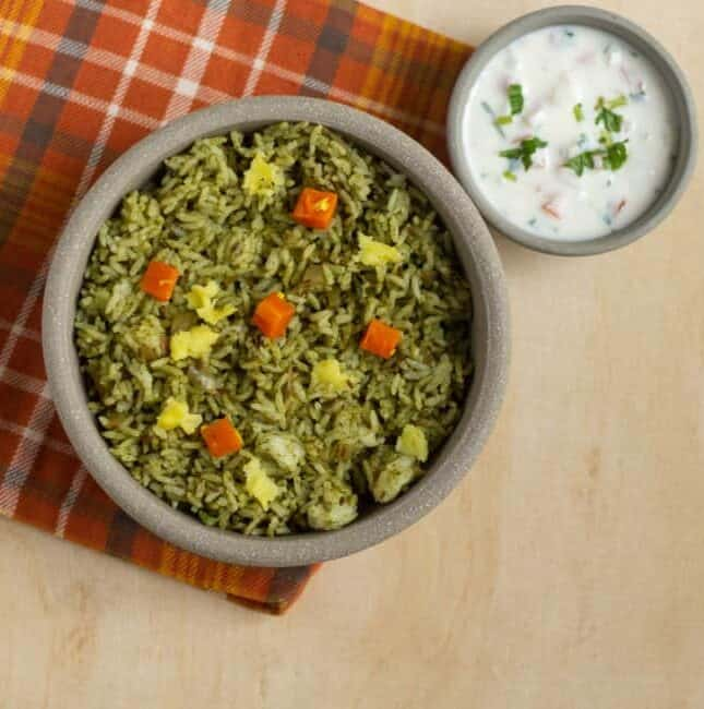 square image of pudina rice served in a ceramic bowl with raita
