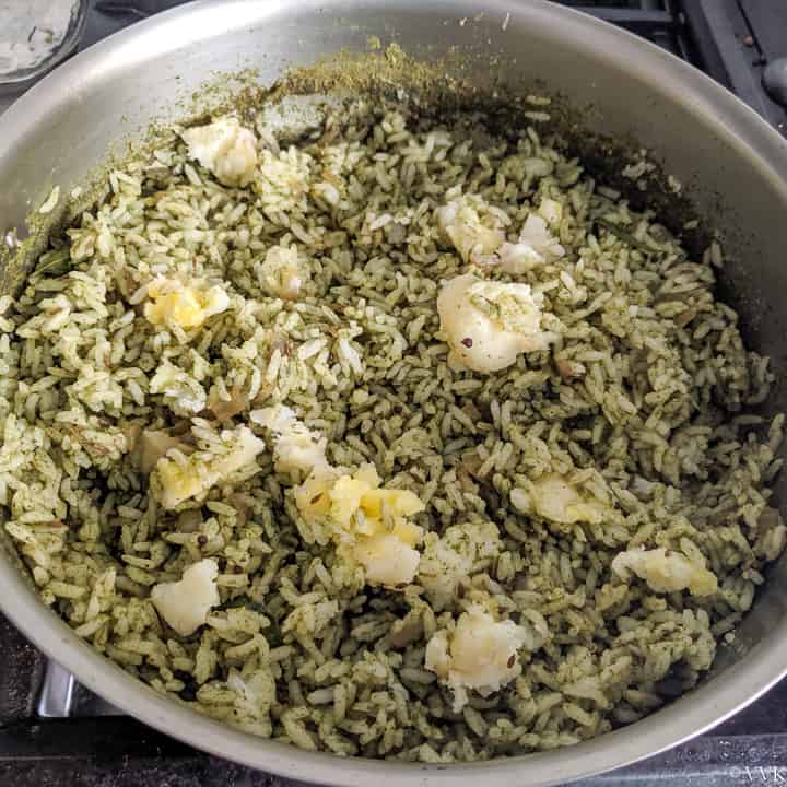 adding rice and mixing it with pudina