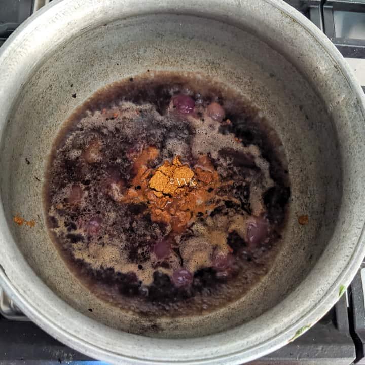 adding sambar powder
