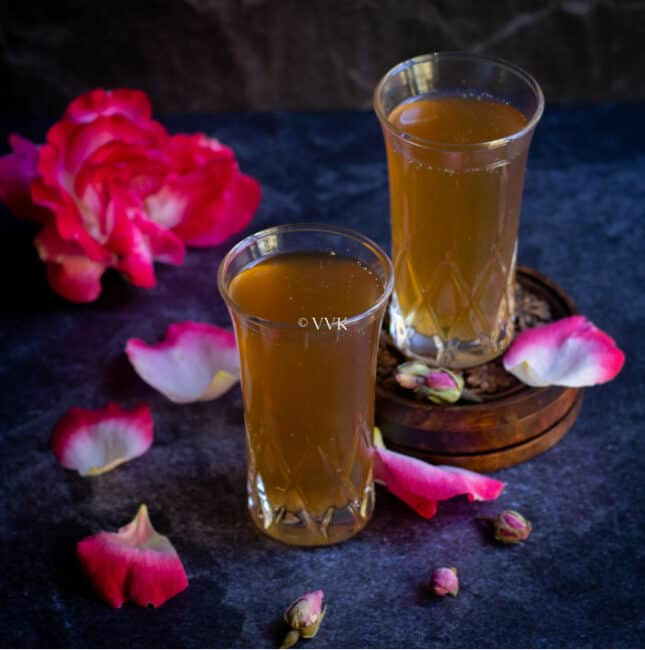 paneer soda served in two glasses with roses on the side