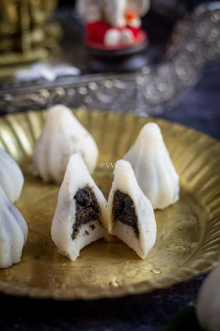 close up shot of sesame seeds kozhukattai cut into half