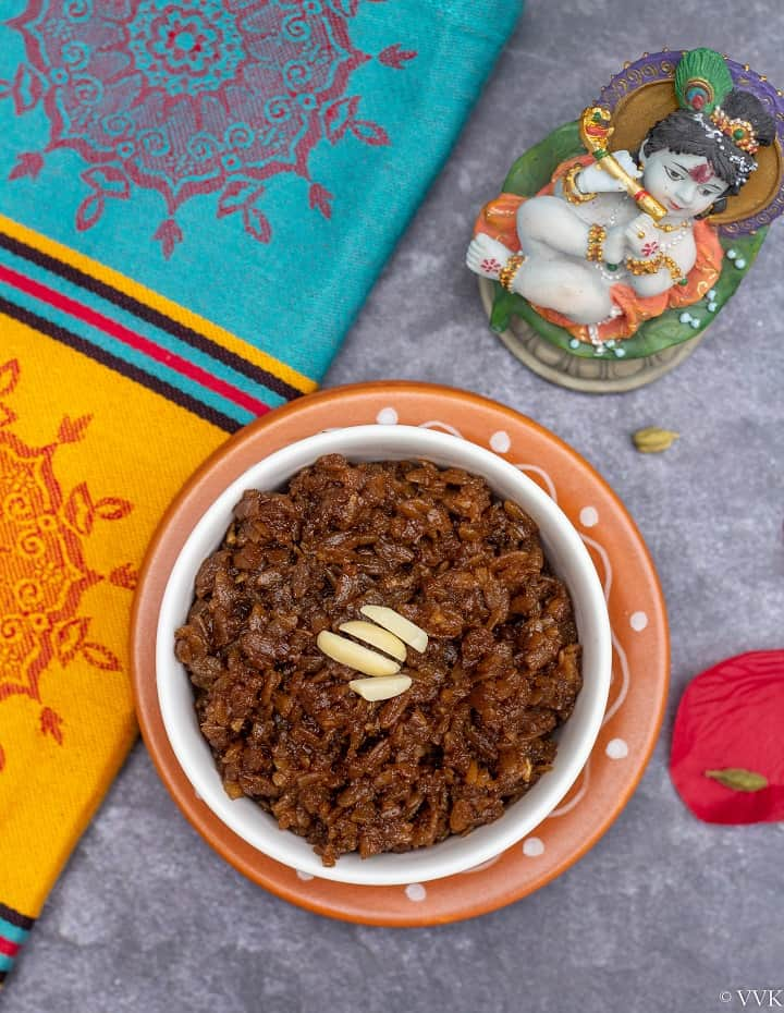 sweet poha with fabric on the side and with a small idol of krishna on the top