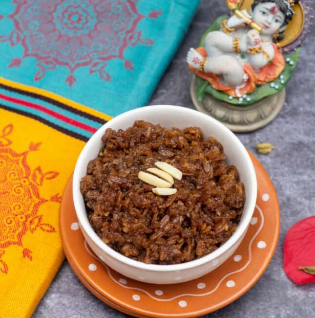 square image of sweet poha with fabric on the side and with a small idol of krishna on the top