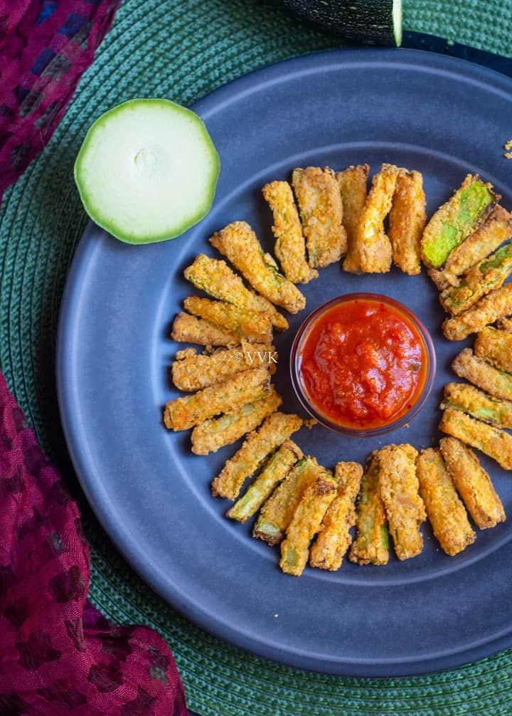 close up shot of zucchini fries with marinara