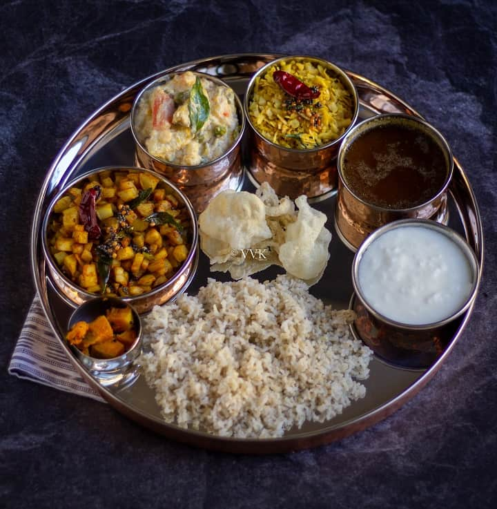 no onion no garlic lunch platter with potata, plantain, rasam, avial and rice