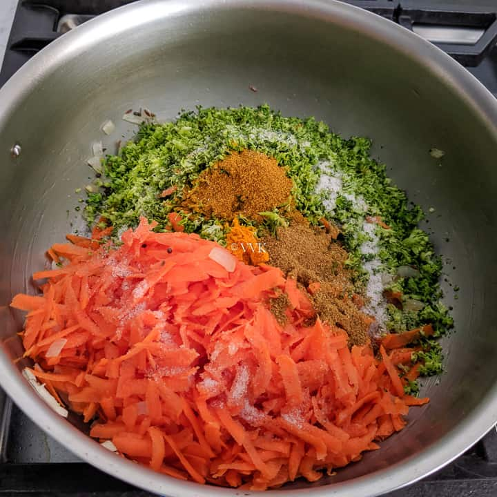 adding broccoli, carrots and spices