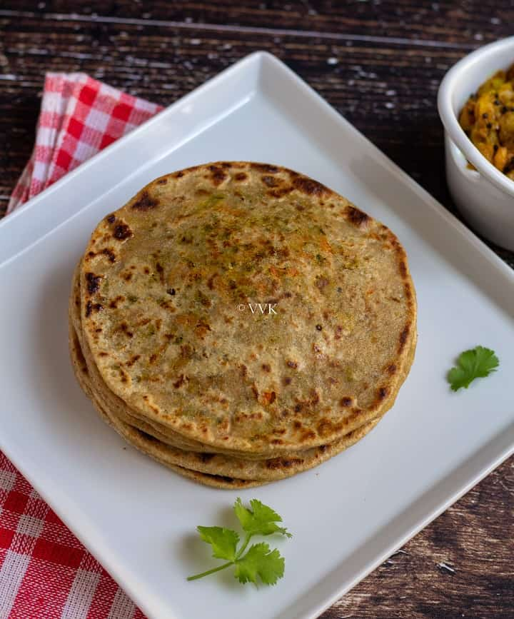 simple broccoli carrot paratha in a white plate