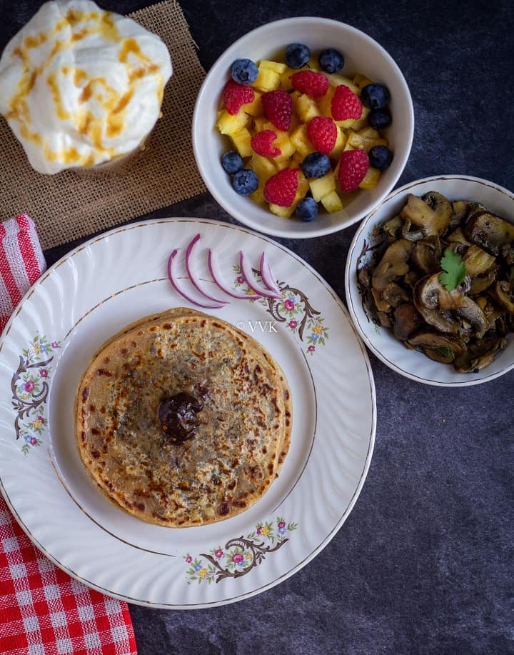 cheese paratha platter with mushrooms, salad and butterbeer