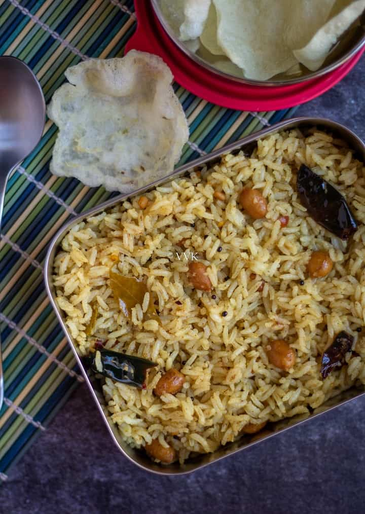 easy tamarind rice in lunch box with fryums on the side