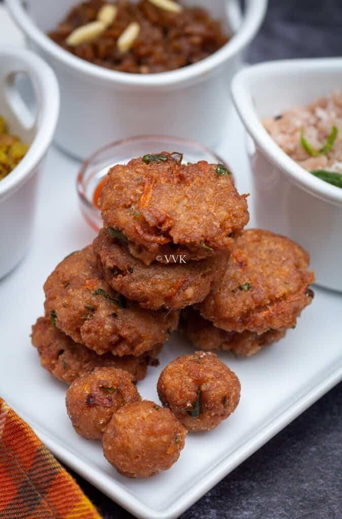 stacked aval vadai in a white plate