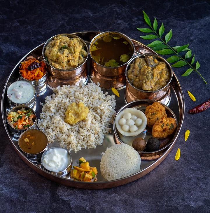 elaborate lunch menu recipes for garuda panchami with curry leaves on the side as garnish