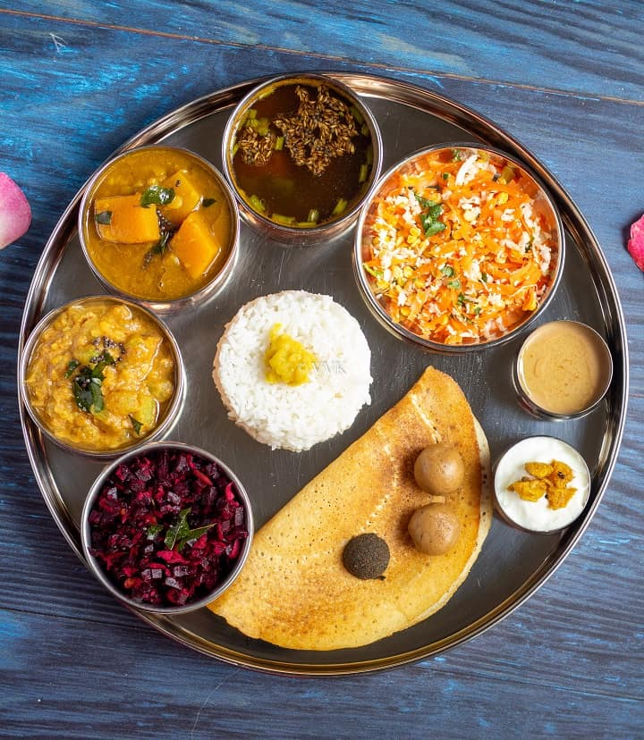 South indian festive special lunch menu for gowri habba where all the dishes are serve in big place and dishes are placed in small bowls