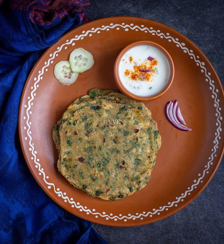 overhead shot of methi paratha with raita