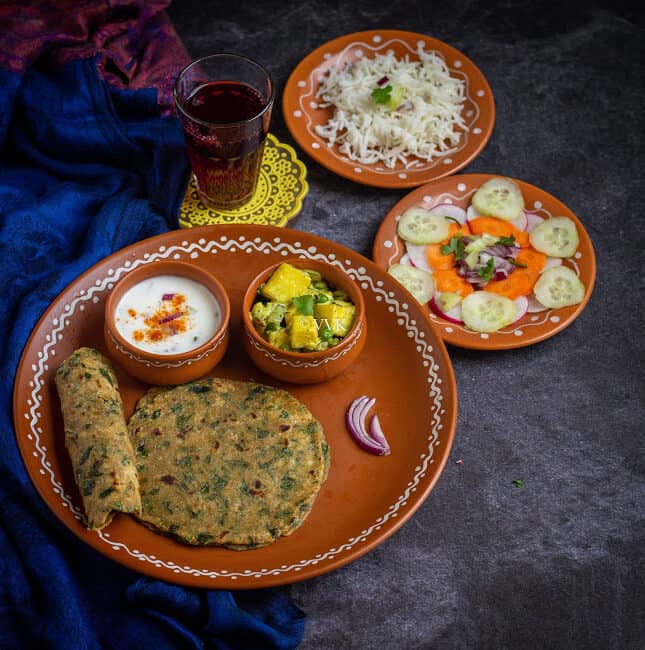 methi paratha thali with paneer and rice and salad