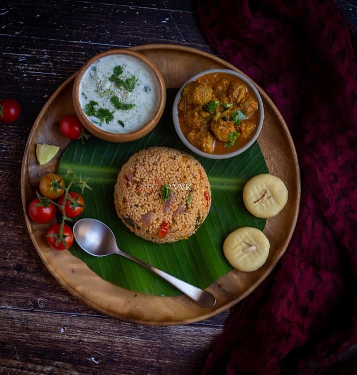 simple millet biryani served with raita, salna and peda