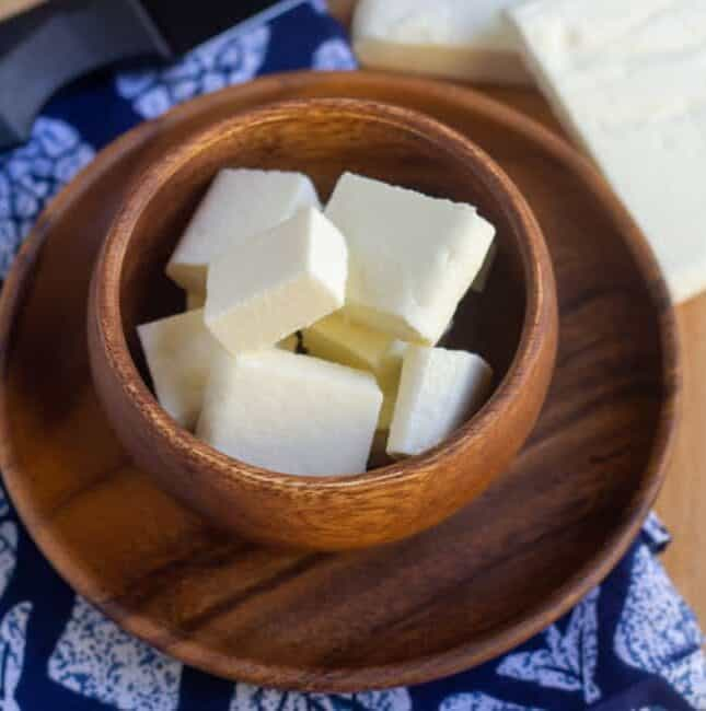 square image of paneer in a wooden bowl
