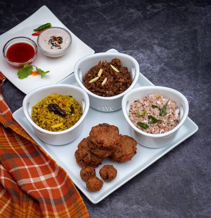 poha platter with two upma, one sweet and appetizer served with chutney and ketchup