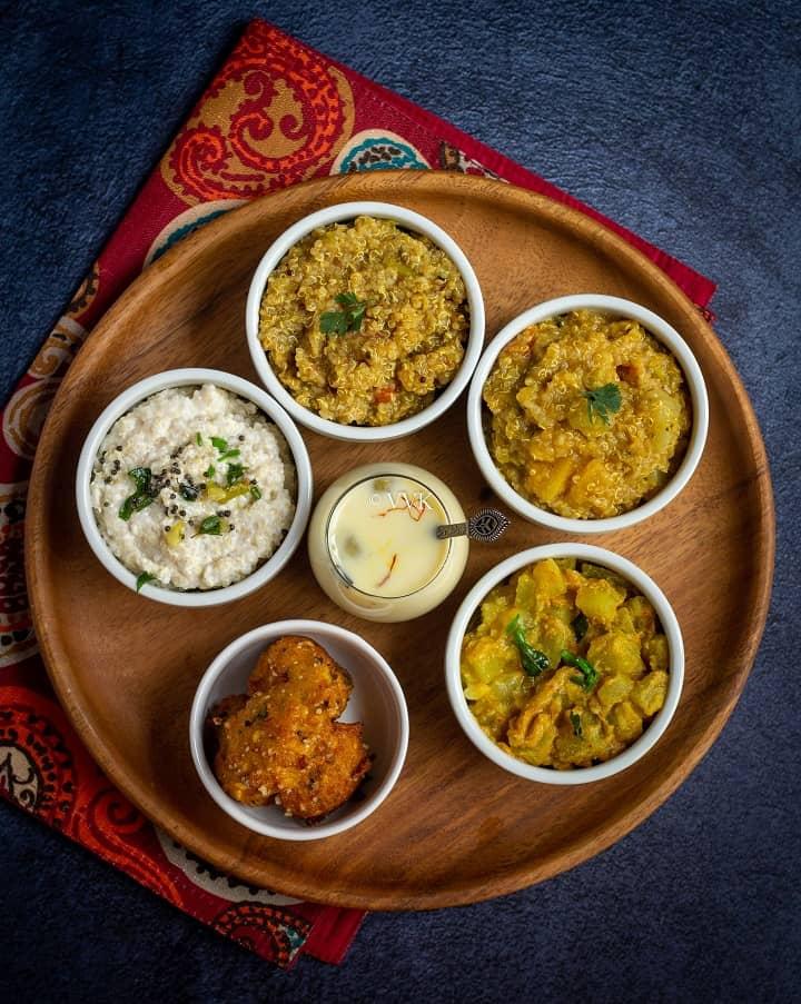 Quinoa platter with rasam rice, sambar rice, yogurt rice, kheer and vadai