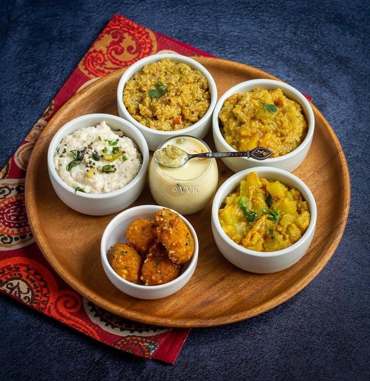 quinoa thali with sambar rice, rasam rice, kheer, yogurt rice all with quinoa
