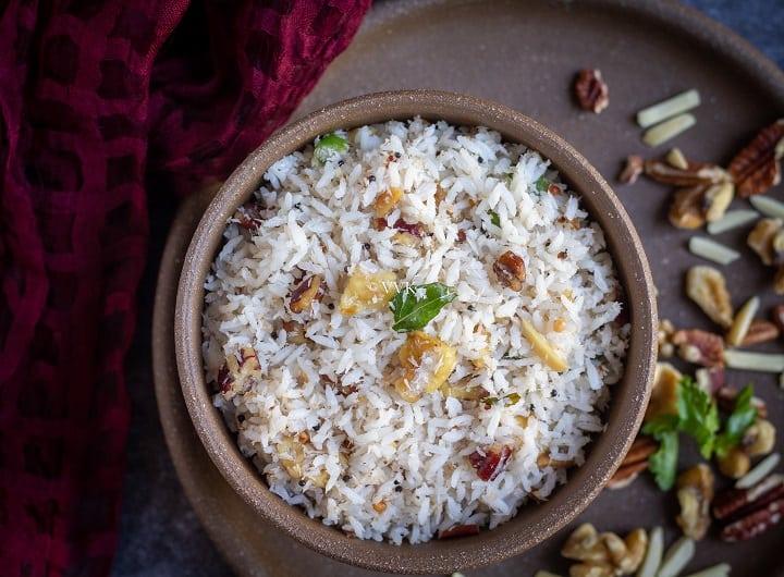 overhead close up shot of thengai sadam in a brown bowl
