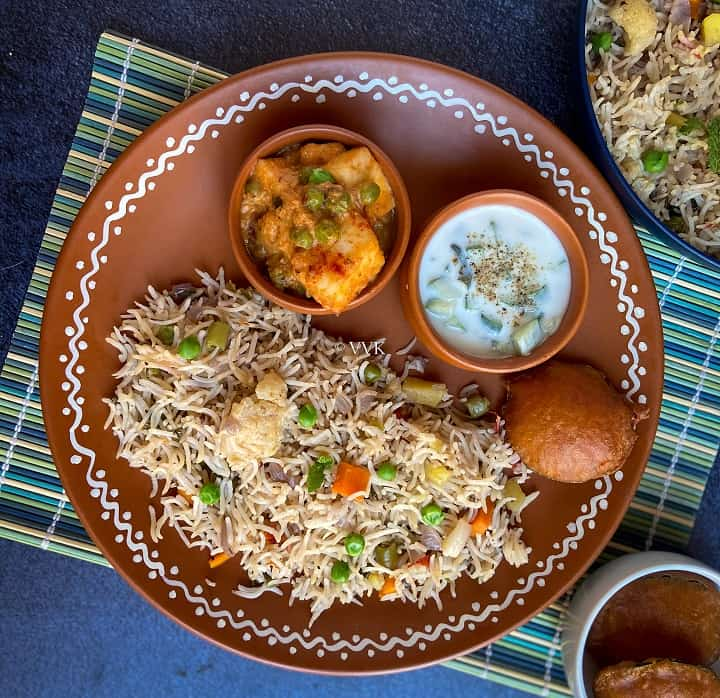 veg pulao platter with raita and matar paneer