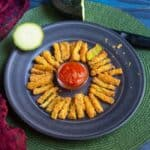 zucchini fries with marinara placed in a tray