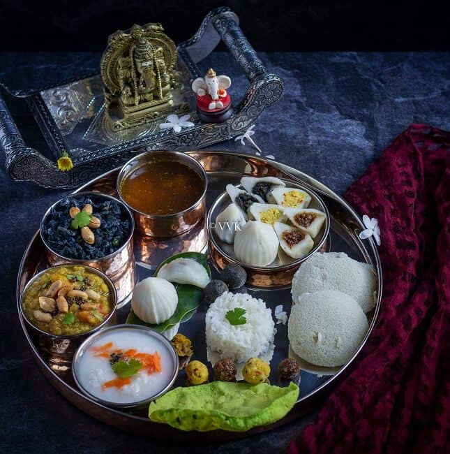 square image of ganesh chaturthi thali with assorted kozhukattai and dishes