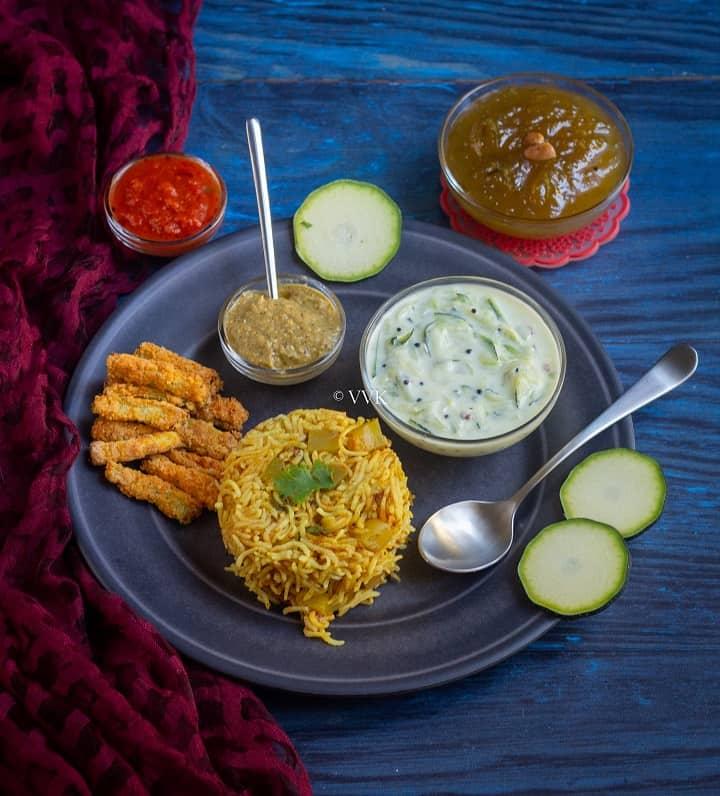simple zucchini platter with zucchini fries, raita, rice, chutney and halwa