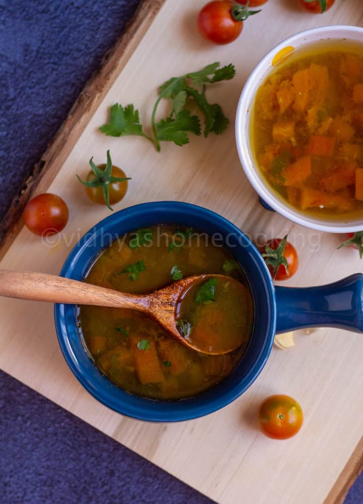 instant pot rasam served in blue ceramic ware