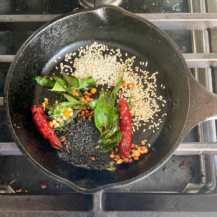adding the sesame seeds and roasting
