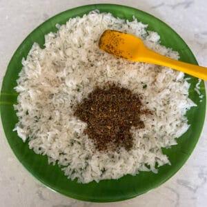 adding the ground powder to the rice