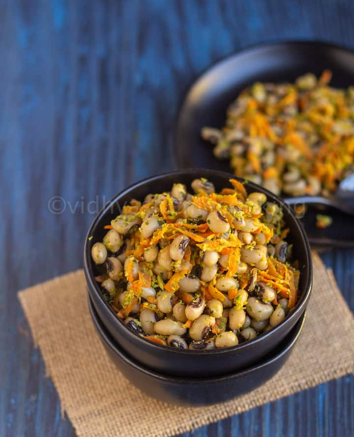 angled shot of black-eyed peas sundal served in stacked black bowls