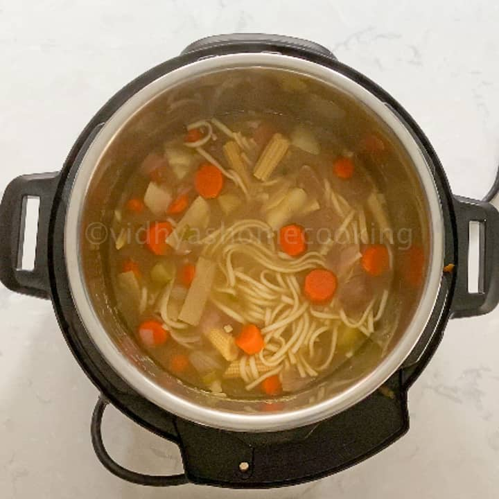 mixing the noodles
