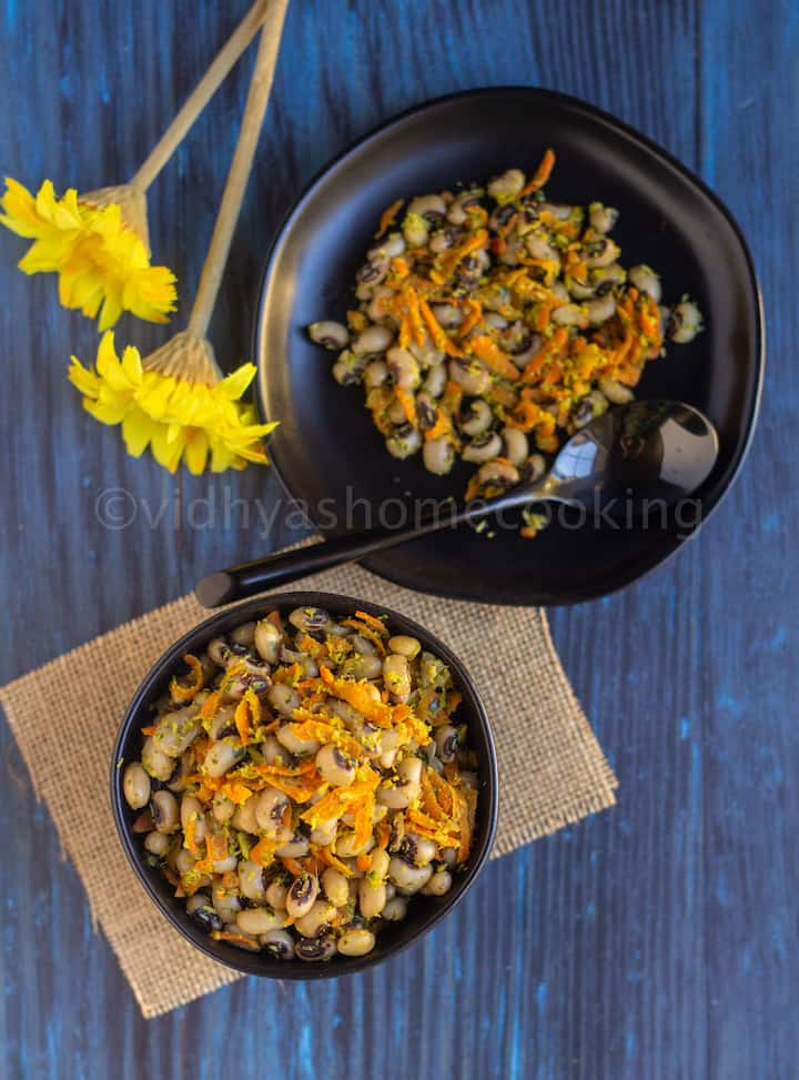 overhead shot of black-eyed peas sundal served in a black bowl and plate