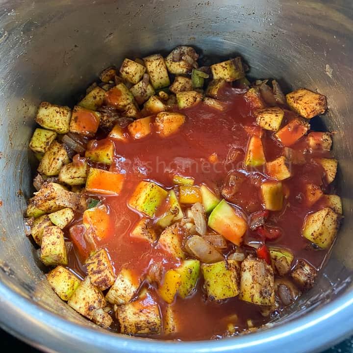 adding the tomato paste
