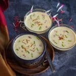 square image of apple basundi served in three bowls