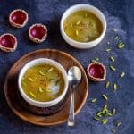 square image of badam halwa served in white bowls