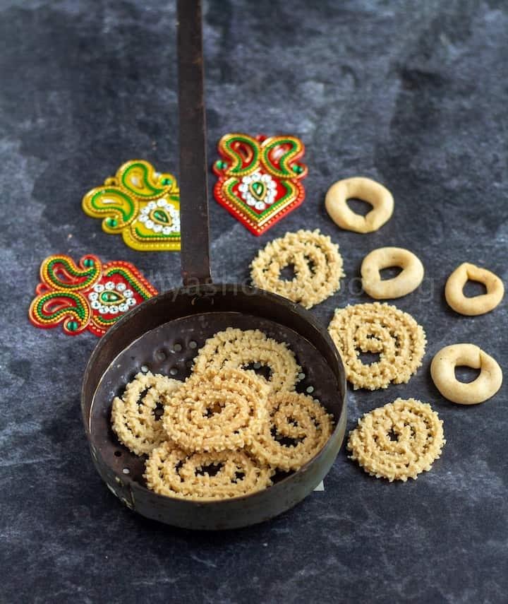 baked murukku in boondi ladle and ring murukku on the sides