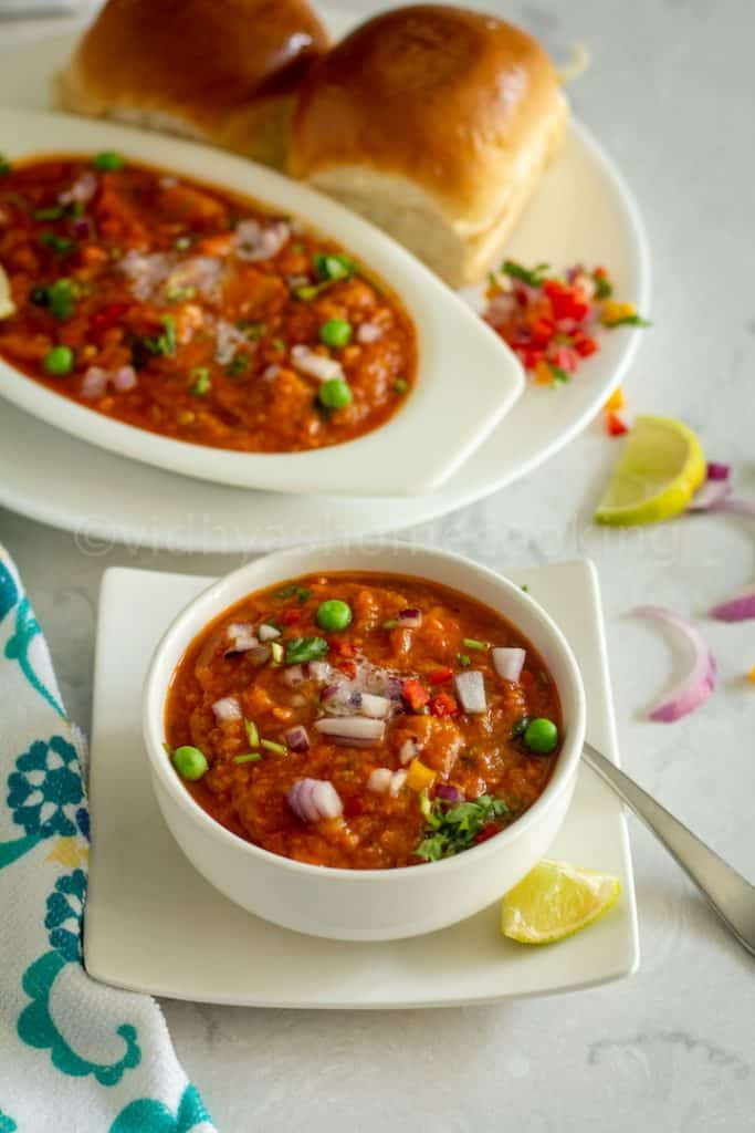 close up shot of pav bhaji placed on a white bowl