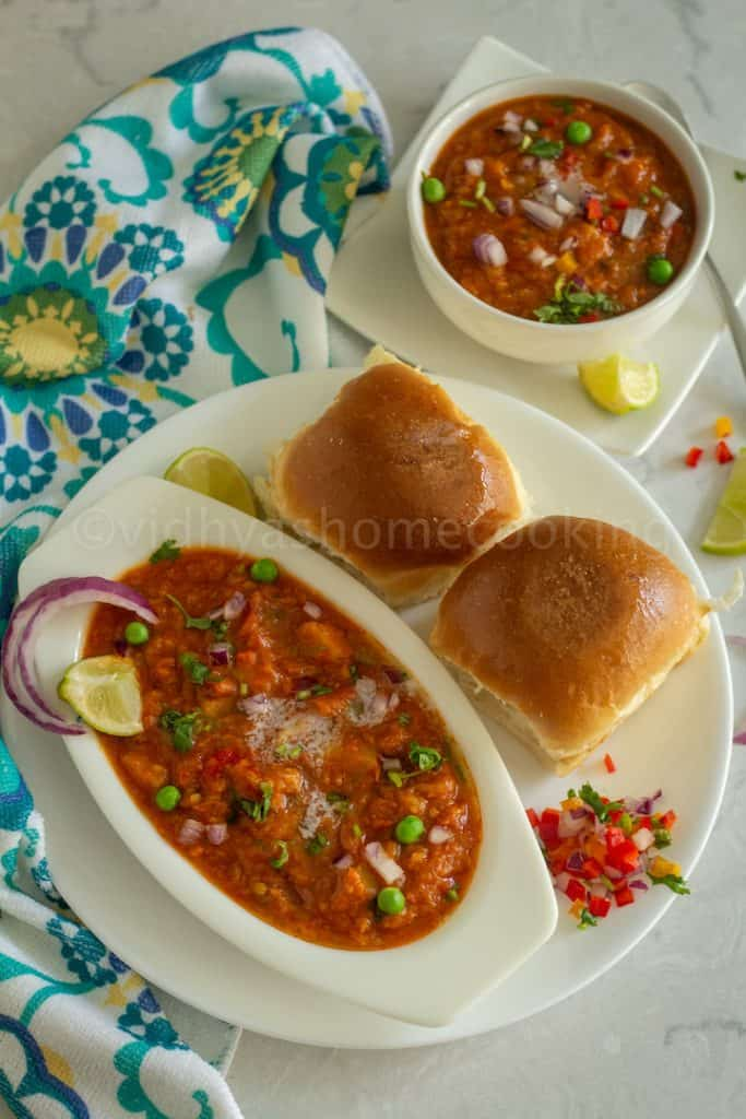 instant pot pav bhaji served in white bowl and on a white plate with a side of bhaji on the side