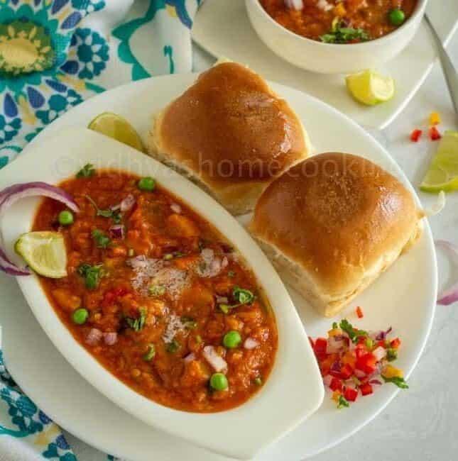 square image of pav bhaji served on white plate