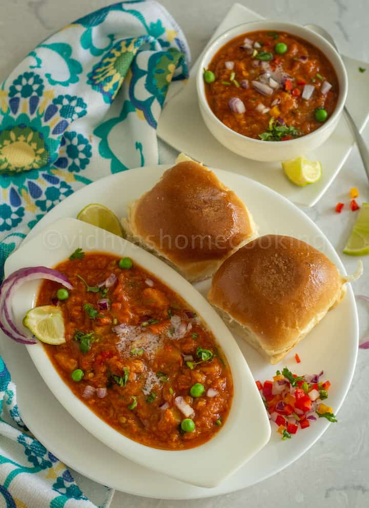 overhead shot of instant pot pav bhaji served in white bowl place on white plate