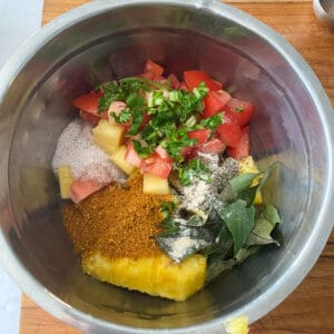 adding all the ingredients to the rasam vessel