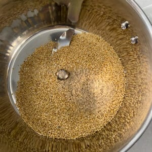 adding cooled down millets to the mixer