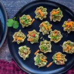 square image of tortilla bhel cups in a black plate