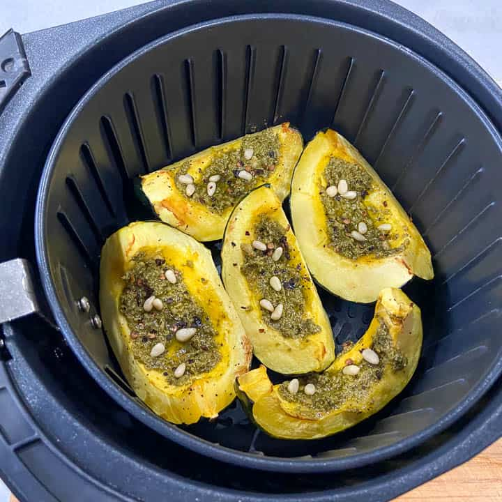 air frying acorn squash with pesto and pine nuts