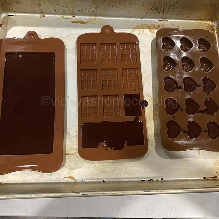 adding chocolate mixture to molds