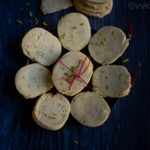 square image of eggless gulab jamun cookies placed on black plate