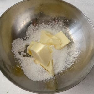 add powdered sugar and butter to mixing bowl