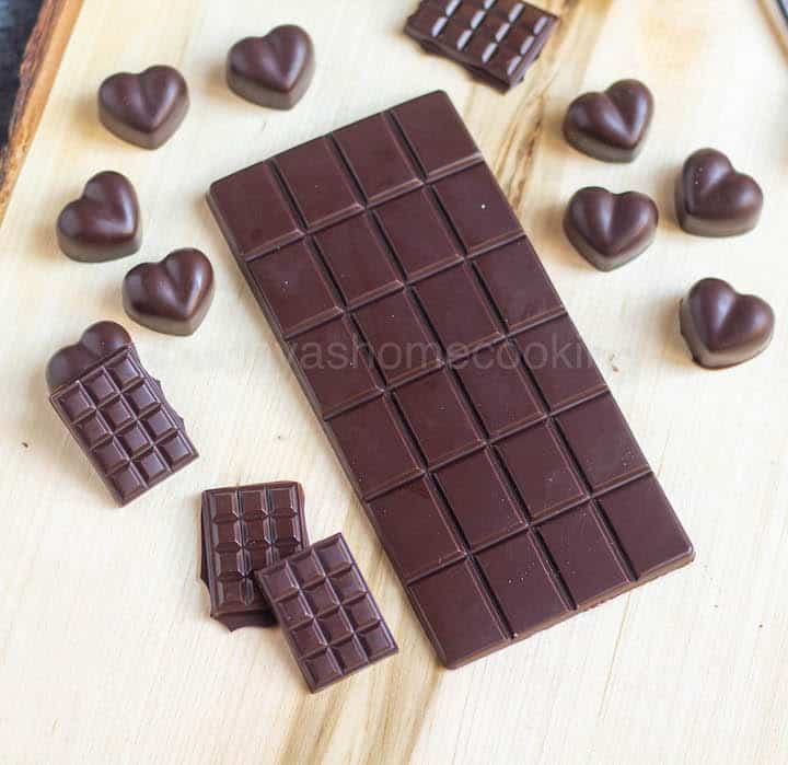 homemade dark chocolates placed on wooden board